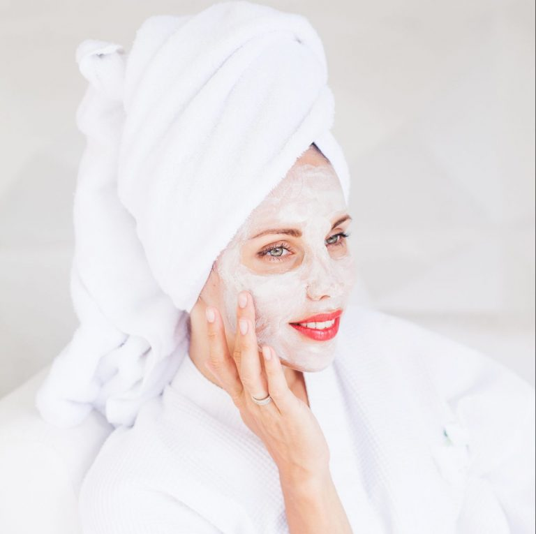 Woman relaxing with an exfoliating facial mask.